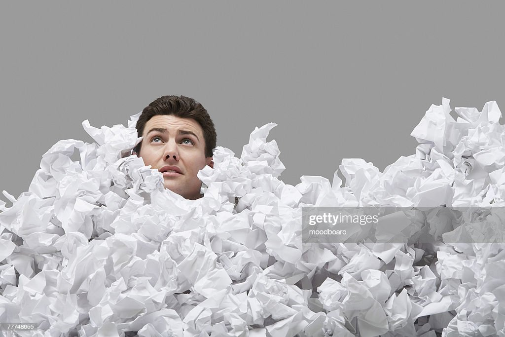 Man Buried in Crumpled Paper