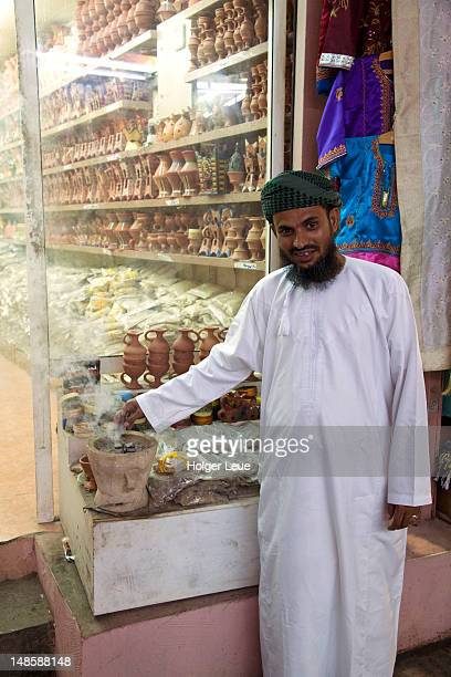 Man burning frankincense at Muscat souq.