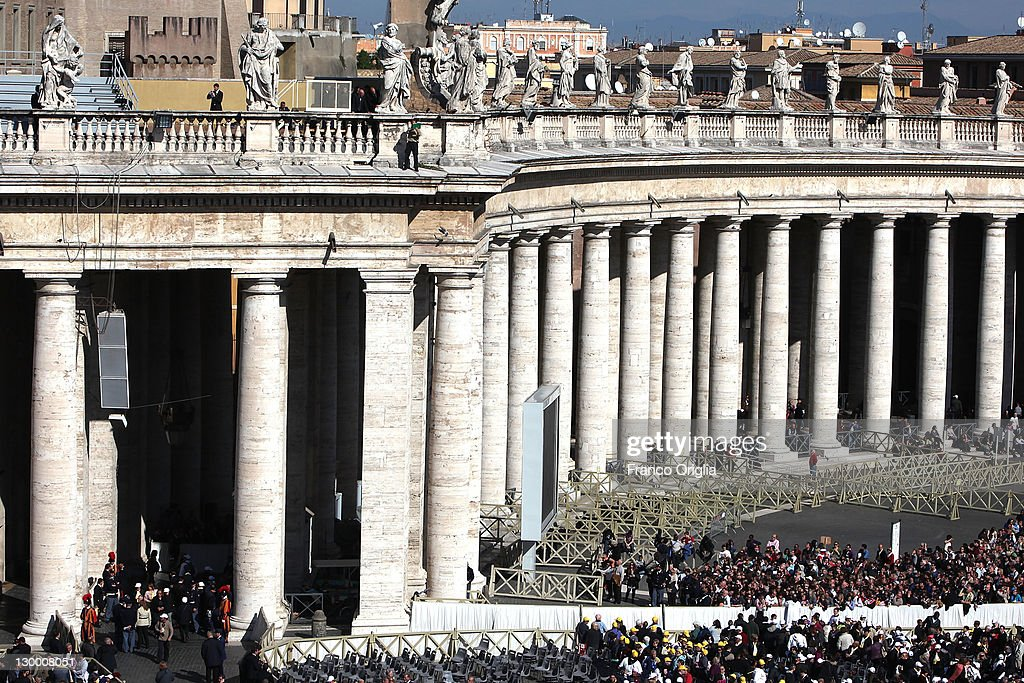 A man burns a copy of the Holy Bible from the top of the St Peter's Colonnade during a Canonisation ceremony held by Pope Benedict XVI on October 23...