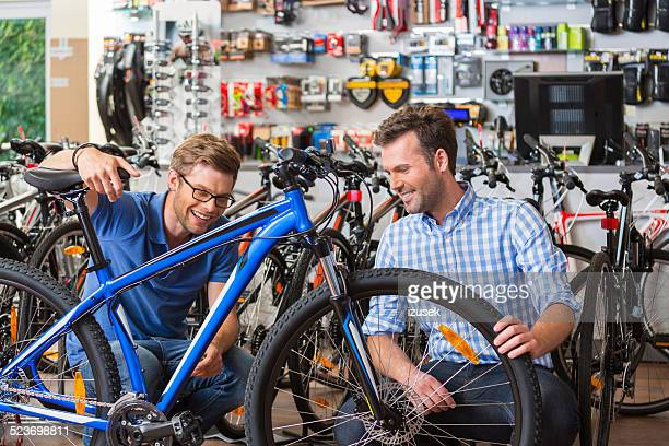 Man buying bicycle in sport store