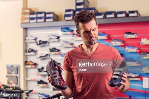 Man buying cycling shoes