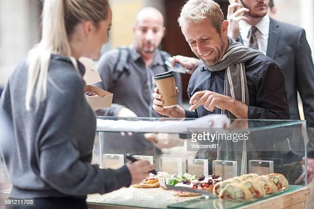 Man buying food at city market