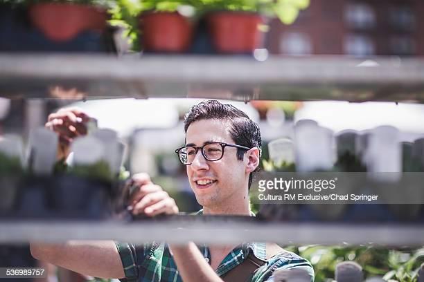 Man buying plants