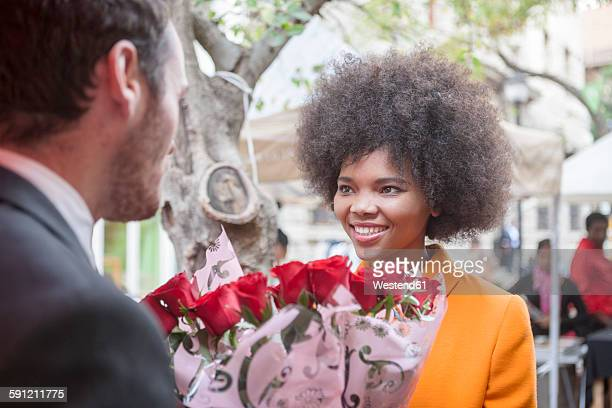 Man buying red roses for a woman