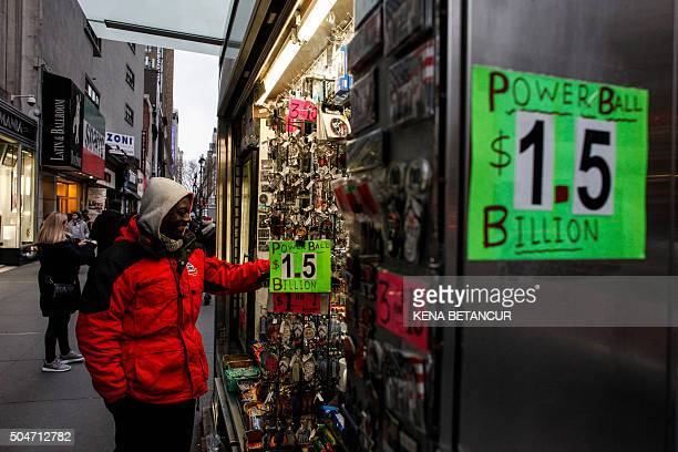 A man buys a Powerball lottery ticket from a stand in New York on January 12 2016 Record sales drove up the largest jackpot in US history to a...