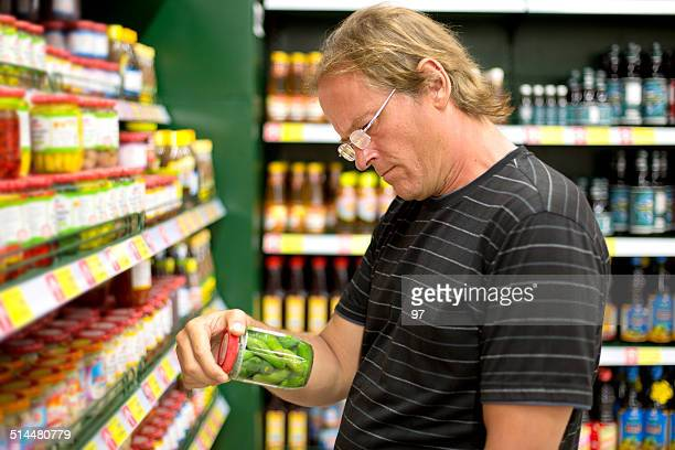 man buys cucumbers in the supermarket