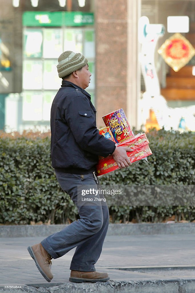 A man buys fireworks for the Chinese New Year, after specialty stores started selling them in Beijing on January 22, 2012 in Beijing, China. The Chinese Lunar New Year, known as the Spring Festival, is based on the Lunisolar Chinese calendar. It is celebrated from the first day of the first month of the lunar year and ends with the Lantern Festival on the fifteenth day.