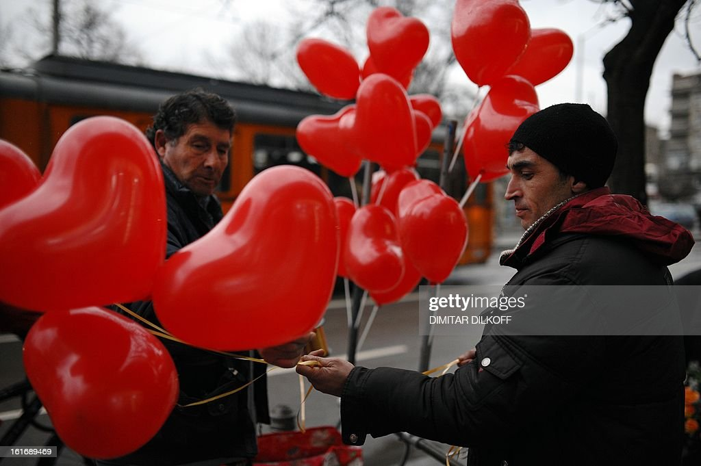 A man buys heart-shaped balloons from a street vendor in Sofia on February 14, 2013.