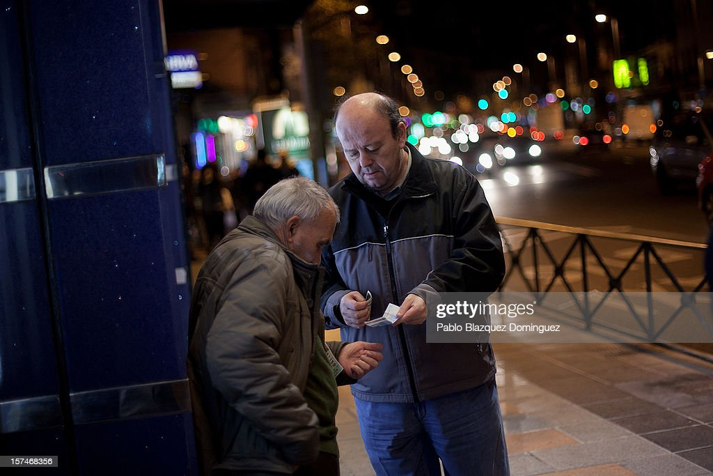 A man buys lottery tickets from a street seller on December 3, 2012 in Madrid, Spain. Spain has formally requested 39.5 billion euros of European funds to bailout a number of its struggling banks.