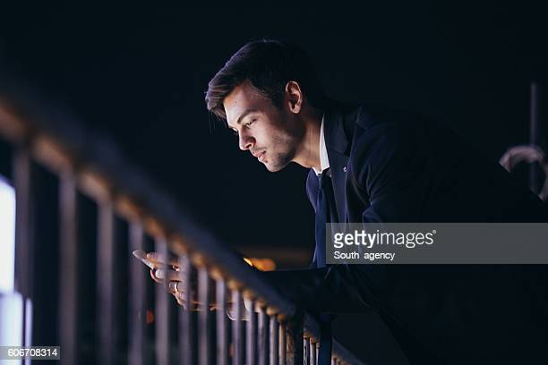 Man by the balcony fence