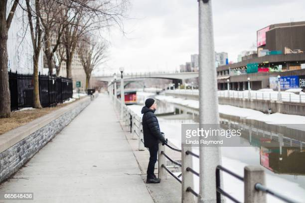 A man by the Rideau Canal