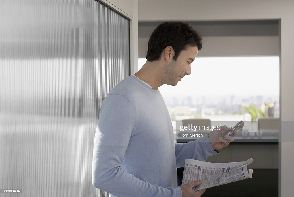 Man calling about classified ad : Stock Photo