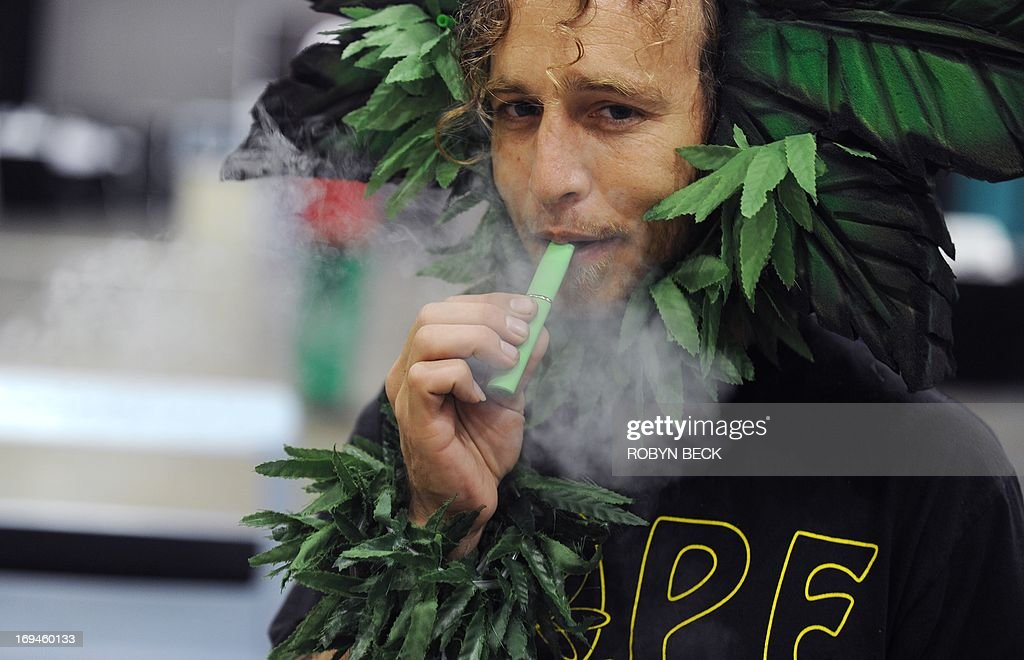 A man calling himself Henry Hemp inhales marijuana using a vaporizer pen at HempCon medical marijuana show, May 24, 2013 at the Los Angeles Convention Center. Thousands of marijuana enthusiasts gathered for the three-day event for exhibits of medical marijuana dispensaries, collectives, evaluation services, legal services and equipment and accessories. Under California state law, people suffering from chronic diseases have the right to grow, buy and use marijuana for medical purposes when recommended by a doctor. In 2003 the Medical Marijuana Protection Act, established an identification card system for medical marijuana patients.