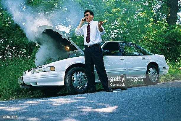 Man calling insurance agent for car trouble