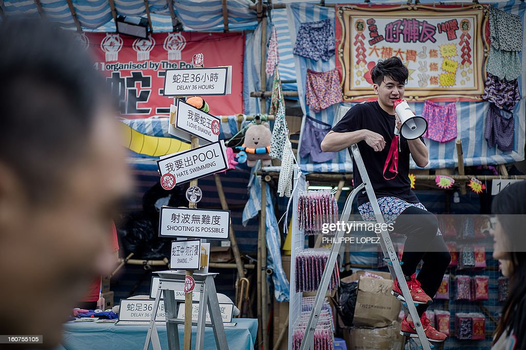 A man calls for customers at a stall selling underwear at a Chinese New Year fair in Hong Kong on February 5, 2013. The Chinese New Year festival falls on February 10, 2013. AFP PHOTO / Philippe Lopez