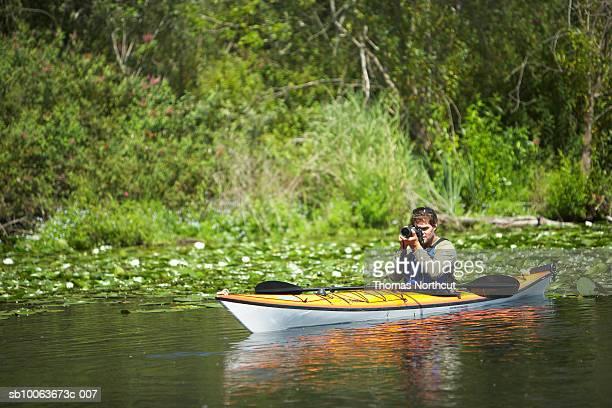 Man canoeing on lake, Seattle, Washington, USA