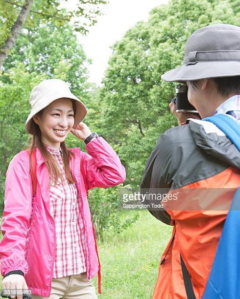 Man Capturing Photo Of Woman