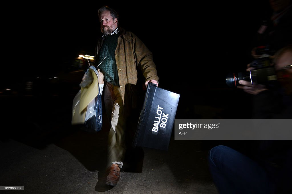 A man carries a ballot box as vote counting begins after polls closed in the Eastleigh by-election in Eastleigh, Hampshire, southern England on February 28, 2013. Polls closed in the southern English town of Eastleigh as residents voted for their new member of parliament in a tight contest that threatens serious repercussions for Britain's main parties.