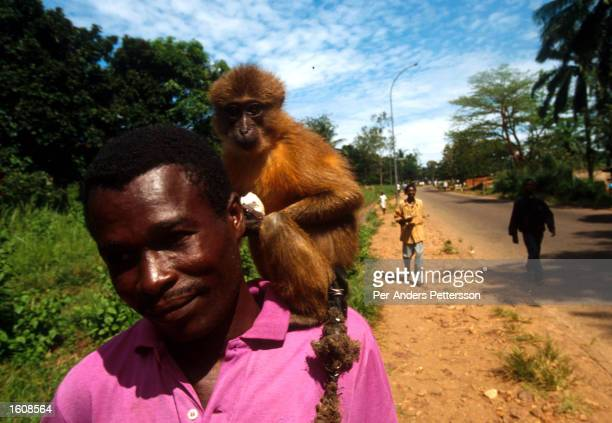 A man carries a monkey on April 10 in Kikwit The Democratic Republic of Congo Kikvit was the center of an Ebola outbreak in 1995 where hundreds of...