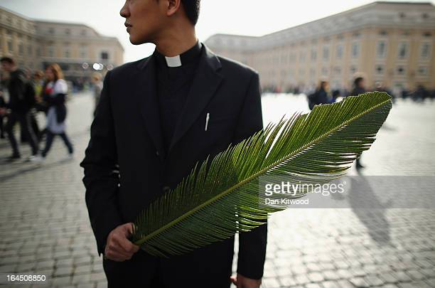 A man carries a palm frond on the day that Pope Francis delivers his blessing to the palms and to the faithful gathered in St Peter's Square during...