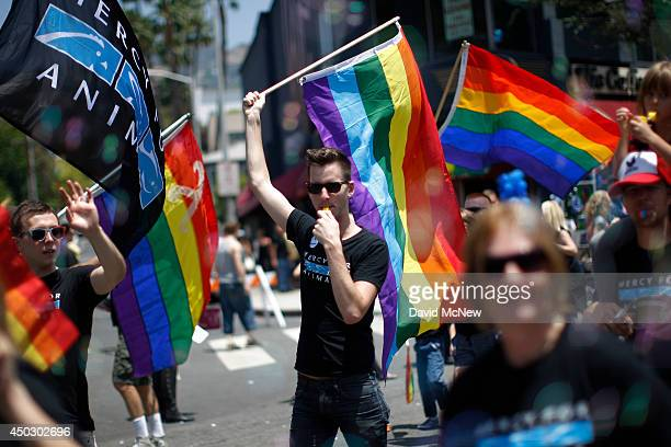 A man carries a rainbow flag and whistle at the LA Pride Parade on June 8 2014 in West Hollywood California The LA Pride Parade and weekend events...