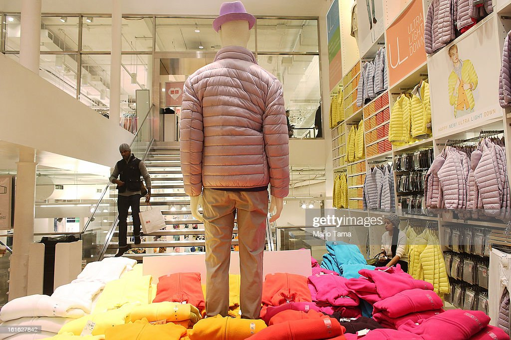 A man carries a shopping bag in a Uniqlo store in Manhattan on February 13, 2013 in New York City. The Commerce Department reported that retail sales were only up slightly in January following tax increases and high gas prices.