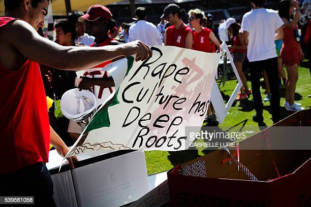 A man carries a sign during the 'Wacky Walk' to show his solidarity for a Stanford rape victim during graduation ceremonies at Stanford University in...