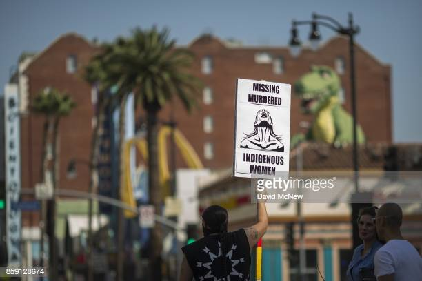 A man carries a sign on Hollywood Boulevard during an event celebrating Indigenous Peoples Day on October 8 2017 in the Hollywood section of Los...