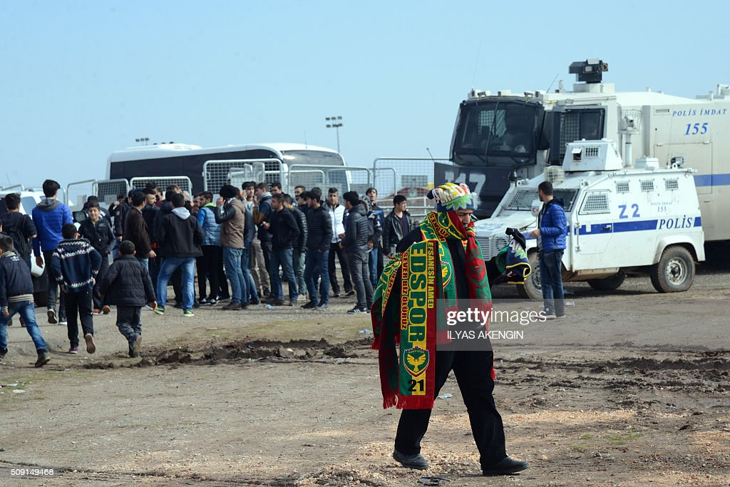 A man carries Amed Spor's scarves prior to the Turkish Cup football match between Amed Spor and Fenerbahce Zirrat on February 9, 2016 in Diyarbakir. The Turkish Football Federation said on February 5, 2016 it had suspended a Kurdish player for statements considered 'ideological propaganda' on the conflict in the Kurdish-majority southeast, adding to a string of cases cracking down on freedom of expression in Turkey. AKENGIN