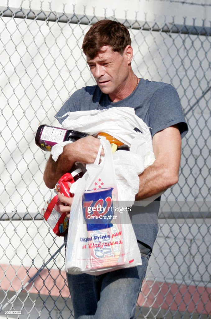 A man carries an armful of supplies including food and drinks taken from a Walgreens store after Hurricane Katrina August 31, 2005 in New Orleans, Louisianna. Devastation is widespread throughout the city with water 12 feet high in some areas. Hundreds are feared dead and thousands were left homeless in Louisiana, Mississippi, Alabama and Florida by the storm.
