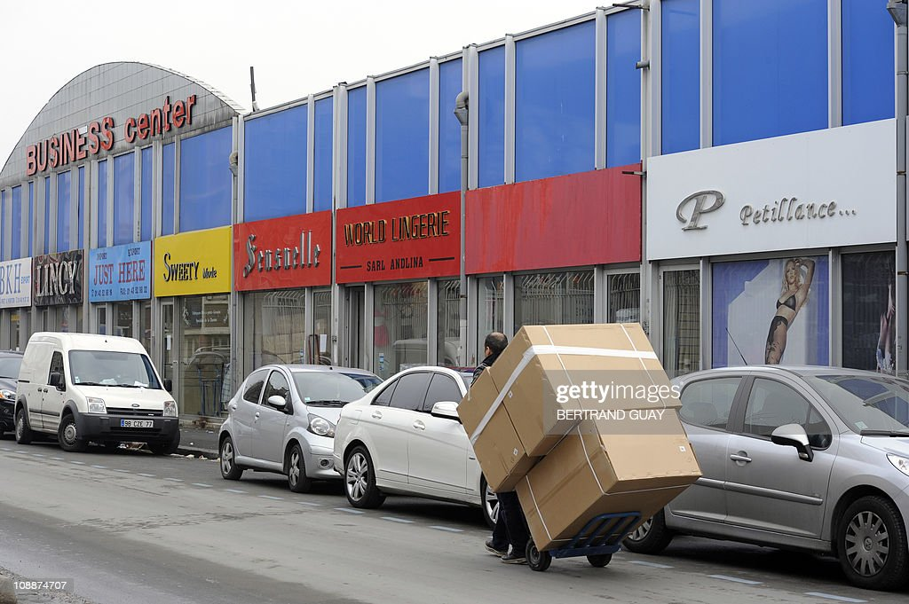 TAIX A man carries goods on a trolley on February 2 2011 in the business center in Aubervilliers north of Paris where 720 textile wholesale shops are...