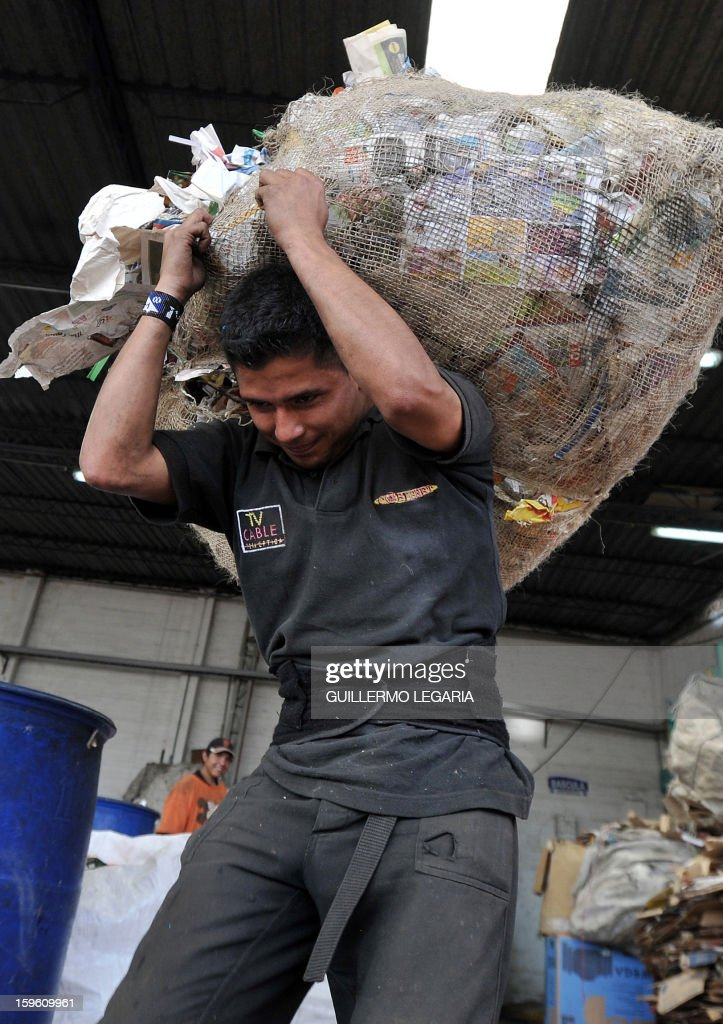 A man carries recyclable garbage at La Alqueria Recycling Center in Bogota, Colombia, on January 17, 2013. Some 60 recyclers classify 10 tons daily of potentially recyclable waste at this recycling center wich is part of Bogota's Mayor program 'Basura Cero' (Zero waste). AFP PHOTO/Guillermo LEGARIA