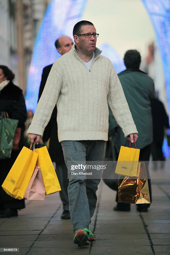 A man carries shopping bags on New Bond Street on December 14, 2009 in London, England. High street stores are expecting a bumper Christmas this year despite the economic dowturn, with shoppers spending around GBP £120 million in the past two days alone.
