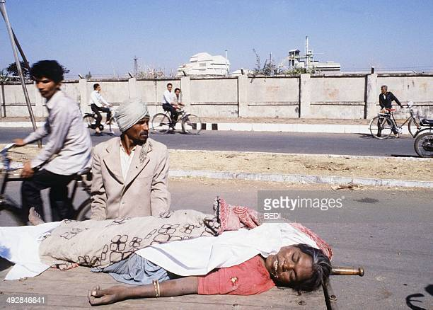 A man carries the body of a victim of the Bhopal tragedy on December 04 1984 in Bhopal where a poison gas leak from the Union Carbide factory killed...