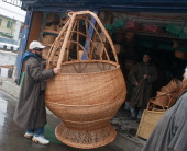A man carries the huge Kangri a traditional Kashmiri firepot manually manufactured by Ghulam Nabi Shaksaaz on January 03 2014 in Srinagar the summer...