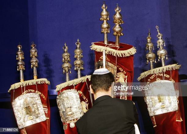 A man carries the torah scroll to the scroll cabinet at the rehearsal for an ordination in the New Synagoge on September 14 2006 in Dresden Germany...