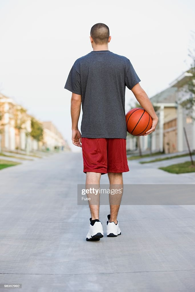 Man carrying a basketball