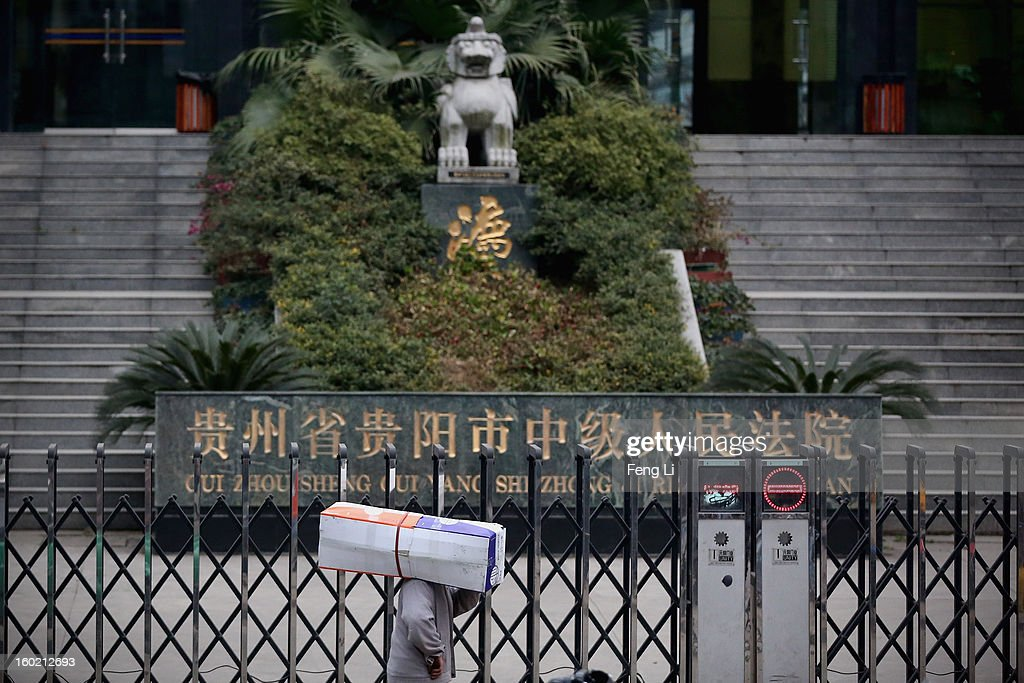 A man carrying a box walks outside Guiyang Intermediate People's Court before a press conference on former Chinese leader Bo Xilai's case on January 28, 2013 in Guiyang, China. 'It is fake information. The trial of Bo Xilai will not open in Guiyang today', Vice-president of Guiyang Intermediate People's Court Jiang Hao said. The trial of Bo Xilai is expected to open after the 'two sessions' in March, China's official newspaper Global Times reports on Monday.