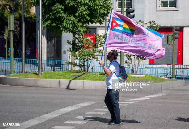 A Man carrying a flag with the message 'Long Live Homosexuality'