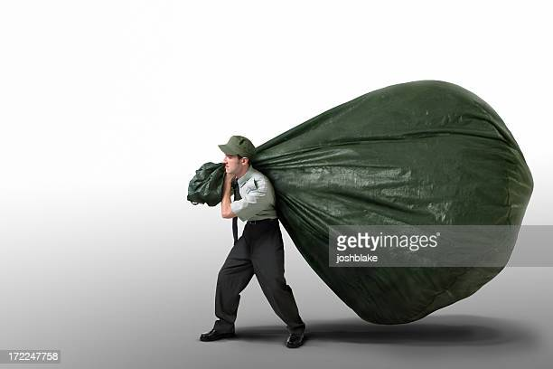 Man carrying a giant bag of garbage on a white background