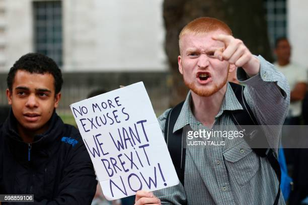 TOPSHOT A man carrying an antiEU proBrexit placard shouts in a counter protest against proEurope marchers on a March for Europe demonstration against...
