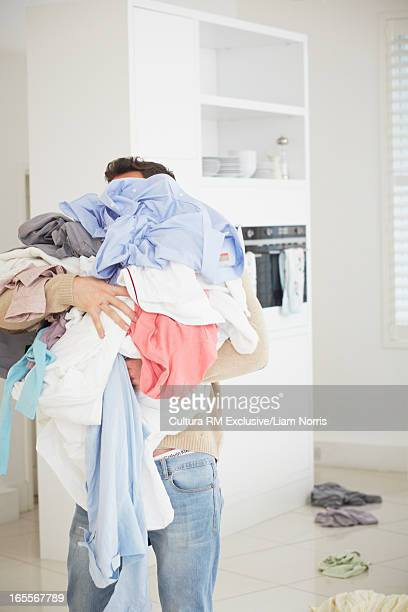 Man carrying armload of laundry