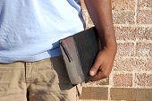 an african american man carrying his Bible
