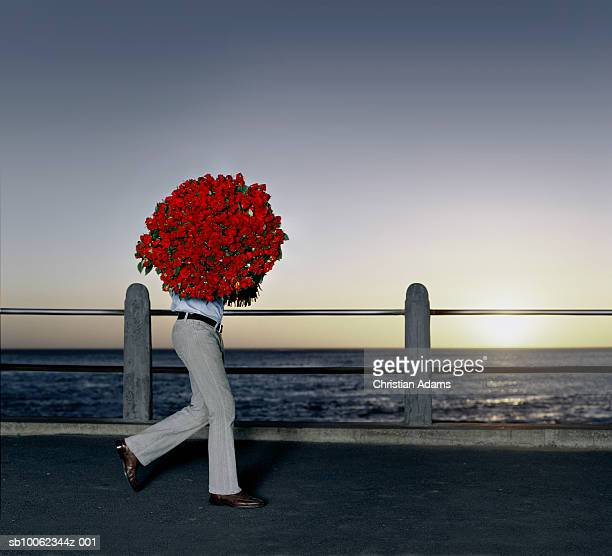 Man carrying bouquet of roses