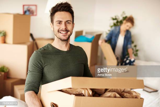 Man carrying box for new house. Debica, Poland