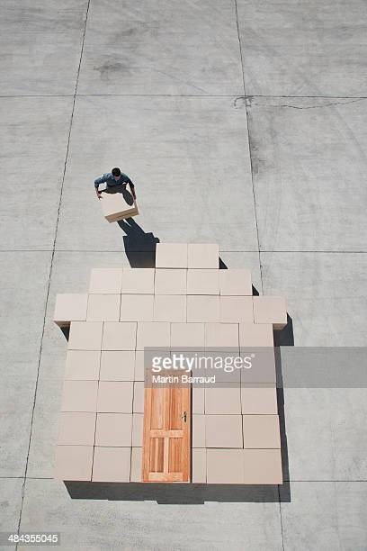 Man carrying boxes outdoors