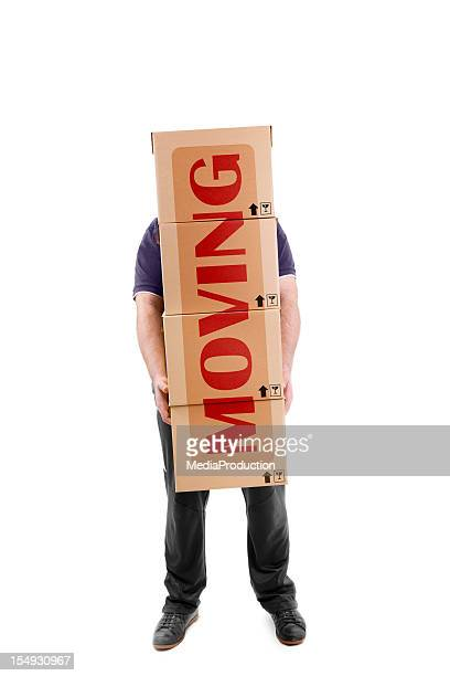 Man carrying boxes with a big MOVING sign across them