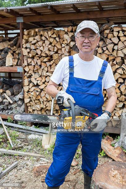 Man carrying chainsaw