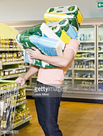 man carrying chemist`s produce in supermarket : Stock Photo