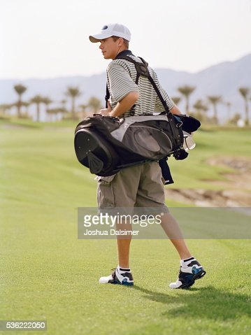 Man carrying golf bag : Stock Photo